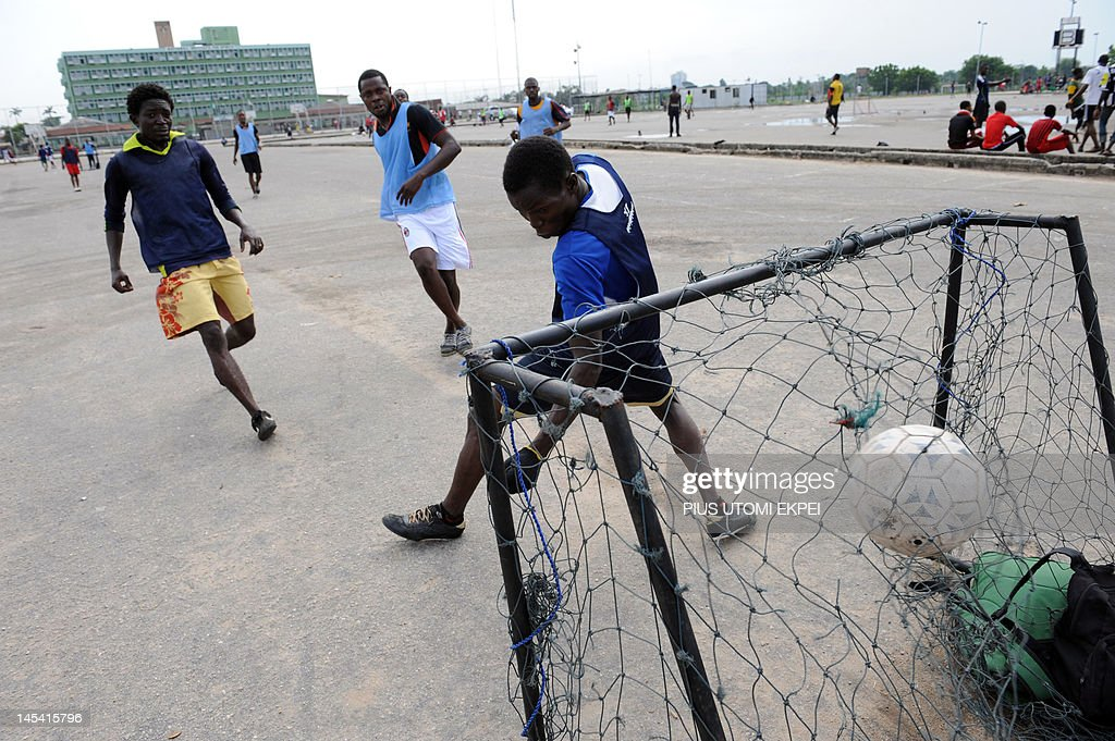 Nigerian youths compete for the ball as  : News Photo