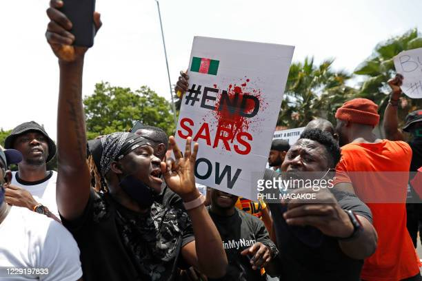 Nigerians based in South Africa protest outside their embassy in Pretoria on October 21, 2020 in solidarity with Nigerian youth who are demanding an...