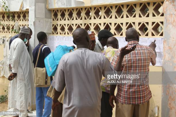 Nigerians check their names agains the voters roll in Maiduguri in Borno State in northeastern Nigeria on February 15 2019 Nigeria's presidential...