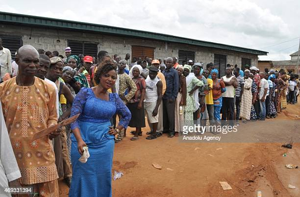 Nigerians wait to cast their votes in front of a polling station during the Governorship election in Lagos Nigeria on April 11 2015