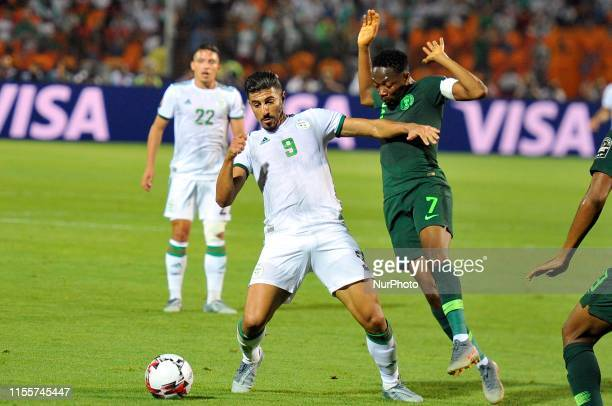 Nigeria's Ahmed Musa fights for the ball with Algeria's forward Baghdad Bounedjah during the 2019 Africa Cup of Nations Semi-final football match...