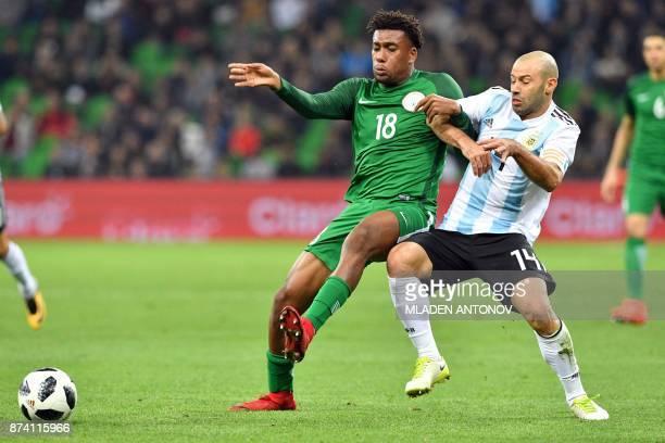 Nigeria's Alexander Iwobi and Argentina's Javier Mascherano vie for the ball during an international friendly football match between Argentina and...