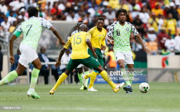 Nigeria's Alexander Iwobi makes a pass during the African Cup of Nations qualifier match between South Africa and Nigeria on November 17 2018 at...