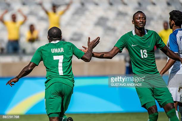 Nigeria's Aminu Umar celebrates with teammate Sadiq Umar after scoring against Honduras during the Rio 2016 Olympic Games men's bronze medal football...