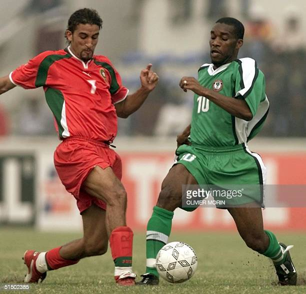 Nigeria's Augustin Okocha and Morocco's Moustapha Hadji fight for the ball 03 February 2000 during their African Nations Cup match in Lagos Nigeria...