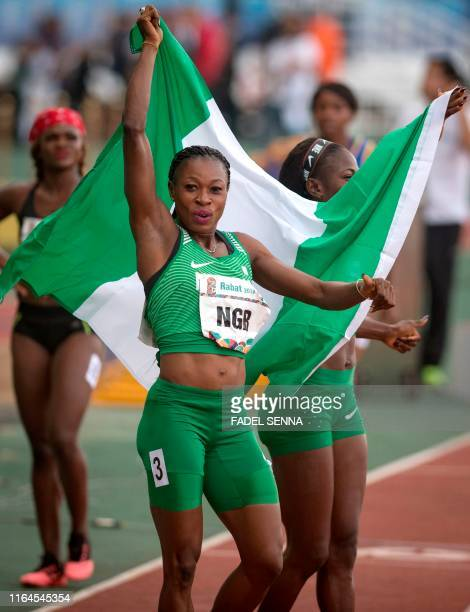 Nigeria's Blessing Oghnewresem Okagbare reacts after she won during the Women's 4x100m Relay at the 12th edition of the African Games on August 28...