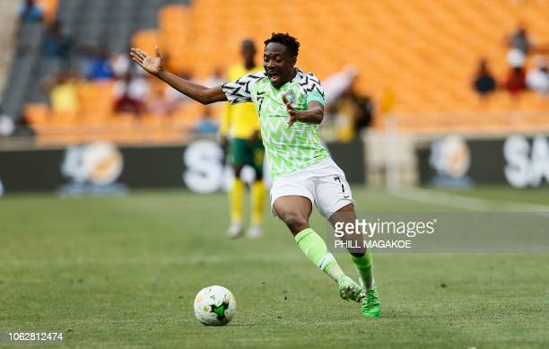Nigeria's captain Ahmed Musa reacts during the African Cup of Nations qualifier match between South Africa and Nigeria on November 17 2018 at Soccer...