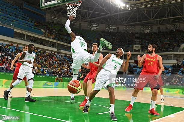 Nigeria's centre Ekene Ibekwe loses his balance during a Men's round Group B basketball match between Nigeria and Spain at the Carioca Arena 1 in Rio...