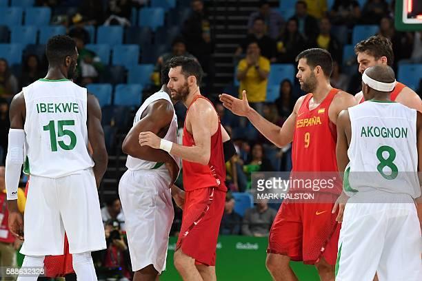 Nigeria's centre Ekene Ibekwe , Spain's small forward Rudy Fernandez , Spain's power forward Felipe Reyes and Nigeria's point guard Josh Akognon...