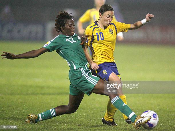 Nigeria's Christie George fights for the ball with Sweden's Hanna Ljungberg during a group B match Sweden vs Nigeria in the Women's Football World...