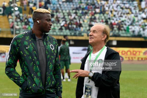 Nigeria's coach Gernot Rohr speaks with Nigeria's striker Victor Osimhen before the FIFA Qatar 2022 World Cup qualification football match between...