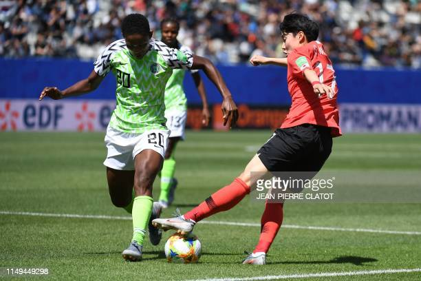 Nigeria's defender Chidinma Okeke vies for the ball with South Korea's forward Lee Geummin during the France 2019 Women's World Cup Group A football...