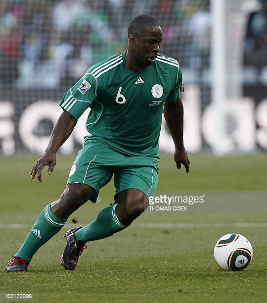 Nigeria's defender Daniel Shittu runs with the ball during the Group B first round 2010 World Cup football match Greece vs Nigeria on June 17 2010 at...