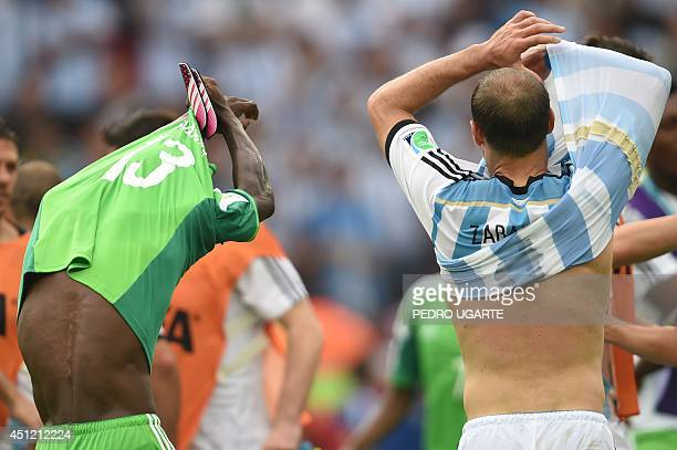 Nigeria's defender Juwon Oshaniwa and Argentina's defender Pablo Zabaleta exchange jerseys after their Group F football match between Nigeria and...