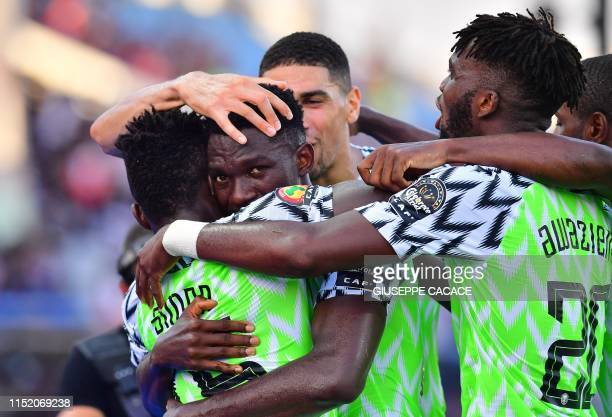 TOPSHOT Nigeria's defender Kenneth Omeruo celebrates his goal during the 2019 Africa Cup of Nations football match between Nigeria and Guinea at the...
