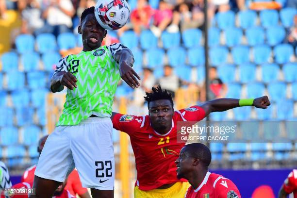 Nigeria's defender Kenneth Omeruo heads the ball to score during the 2019 Africa Cup of Nations football match between Nigeria and Guinea at the...