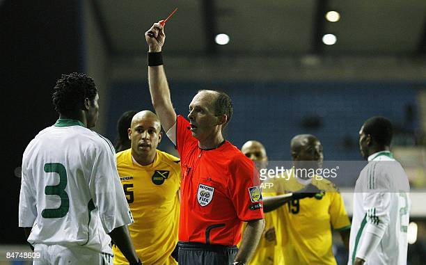 Nigeria's defender Taye Taiwo is shown a red card by referee Mike Dean during their international friendly fopotball match against Jamaica at the The...
