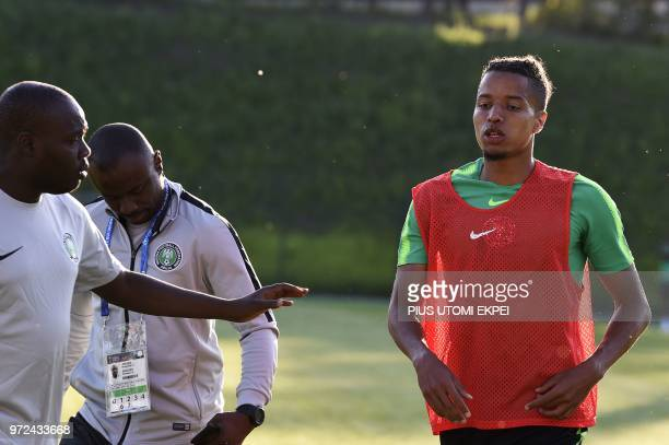 Nigeria's defender Tyronne Ebuehi leaves the pitch bleeding from the nose following a collision with a teammate during a training session at...