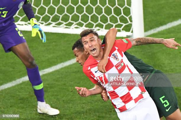 Nigeria's defender William TroostEkong makes a fault on Croatia's forward Mario Mandzukic during the Russia 2018 World Cup Group D football match...