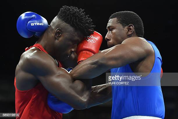 Nigeria's Efe Ajagba blocks Trinidad and Tobago's Nigel Paul during the Men's Super Heavy at the Rio 2016 Olympic Games at the Riocentro Pavilion 6...