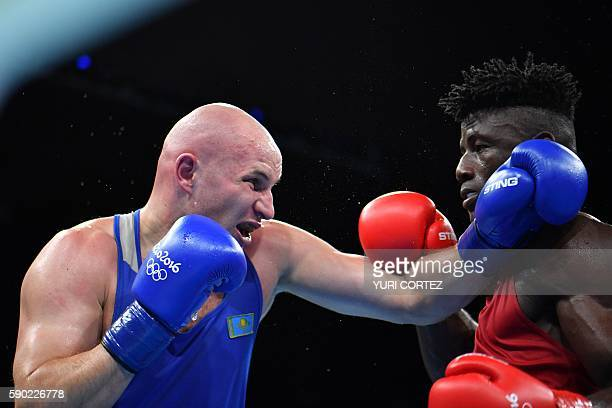 Nigeria's Efe Ajagba fights Kazakhstan's Ivan Dychko during the Men's Light Welter Quarterfinal 4 match at the Rio 2016 Olympic Games at the...