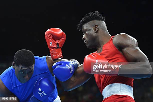 Nigeria's Efe Ajagba fights Trinidad and Tobago's Nigel Paul during the Men's Super Heavy at the Rio 2016 Olympic Games at the Riocentro Pavilion 6...