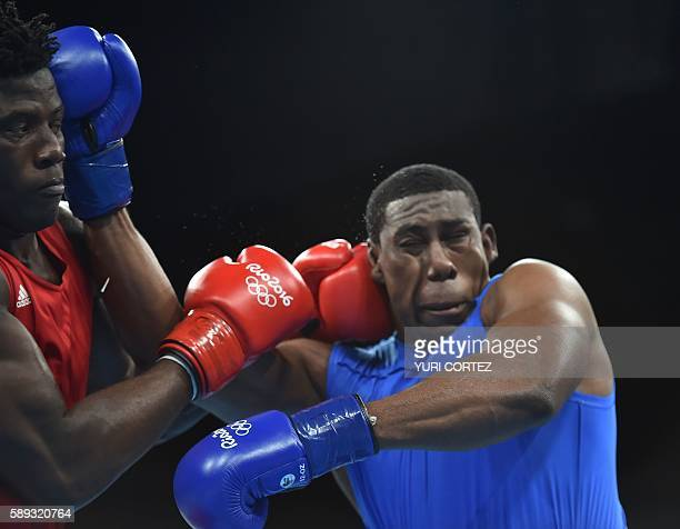 Nigeria's Efe Ajagba lands a punch on Trinidad and Tobago's Nigel Paul during the Men's Super Heavy at the Rio 2016 Olympic Games at the Riocentro...