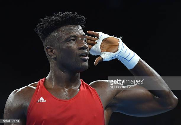 Nigeria's Efe Ajagba reacts after winning against Trinidad and Tobago's Nigel Paul during the Men's Super Heavy at the Rio 2016 Olympic Games at the...