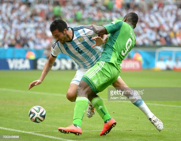 Nigeria's Emmanuel Emenike and Argentina's Ezequiel Garay battle for the ball