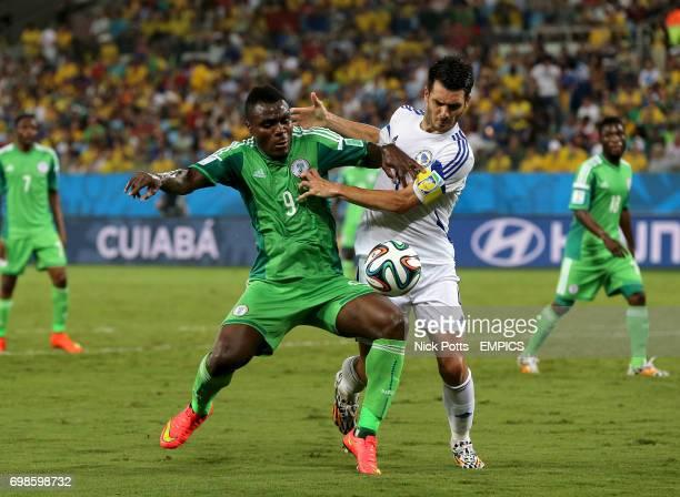 Nigeria's Emmanuel Emenike and Bosnia Herzegovina's Emir Spahic battle for the ball