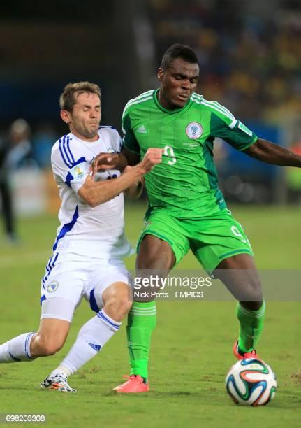 Nigeria's Emmanuel Emenike and Bosnia Herzegovina's Senad Lulic battle for the ball