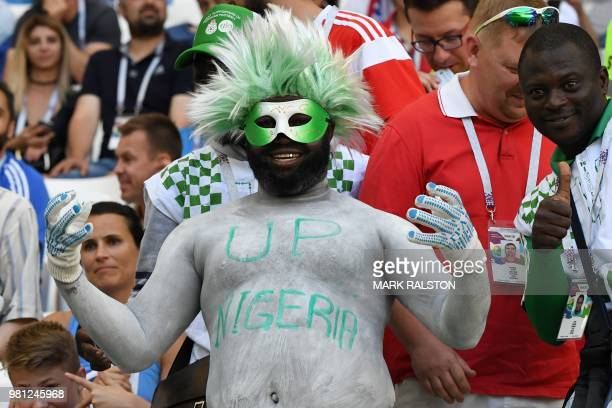 A Nigeria's fan sporting a wig gestures as he waits in the grandstand before the Russia 2018 World Cup Group D football match between Nigeria and...