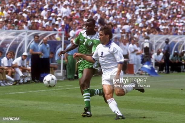Nigeria's Finidi George in action with Italy's Antonio Benarrivo