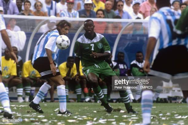 Nigeria's Finidi George plays the ball past Argentina's Claudio Caniggia