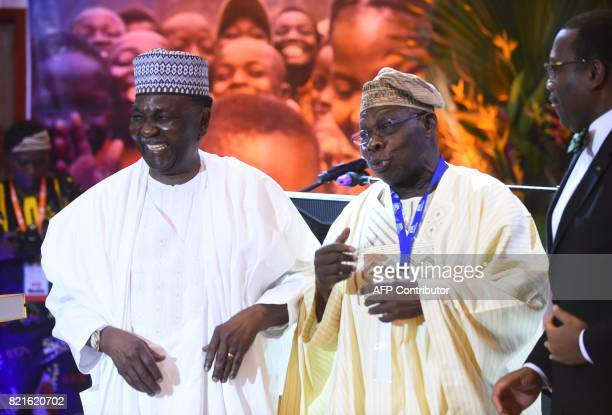 Nigeria's former President Olusegun Obasanjo speaks flanked by former military Head of State General Yakubu Gowon and President of African...