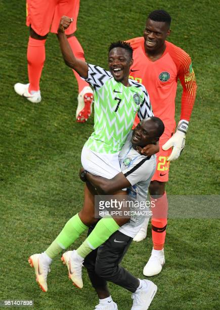Nigeria's forward Ahmed Musa and Nigeria's goalkeeper Francis Uzoho celebrate with a team staff member at the end of the Russia 2018 World Cup Group...