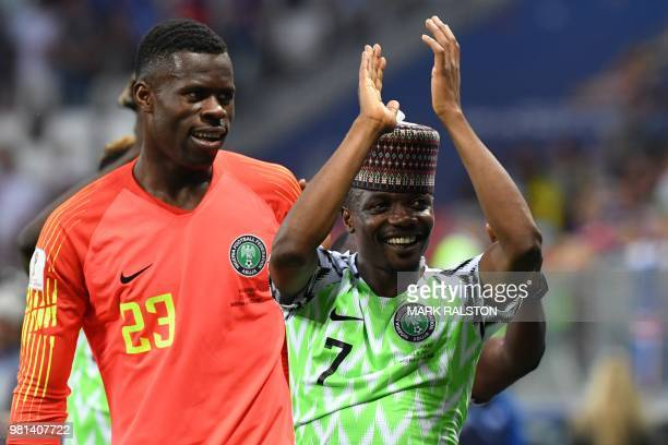Nigeria's forward Ahmed Musa and Nigeria's goalkeeper Francis Uzoho celebrate their victory at the end of the Russia 2018 World Cup Group D football...