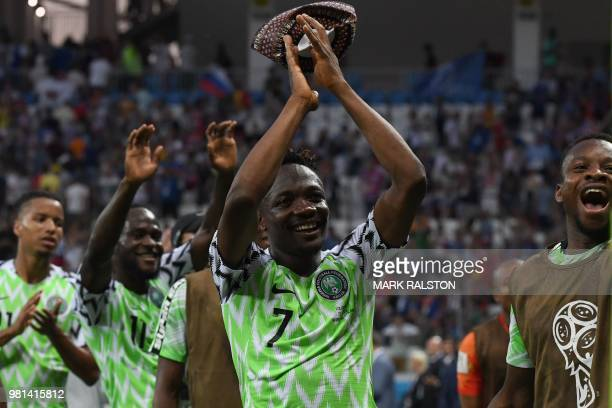 Nigeria's forward Ahmed Musa and teammates celebrate their victory at the end of the Russia 2018 World Cup Group D football match between Nigeria and...