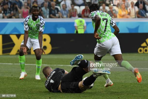 Nigeria's forward Ahmed Musa avoids Iceland's goalkeeper Hannes Halldorsson on his way to score their second goal during the Russia 2018 World Cup...