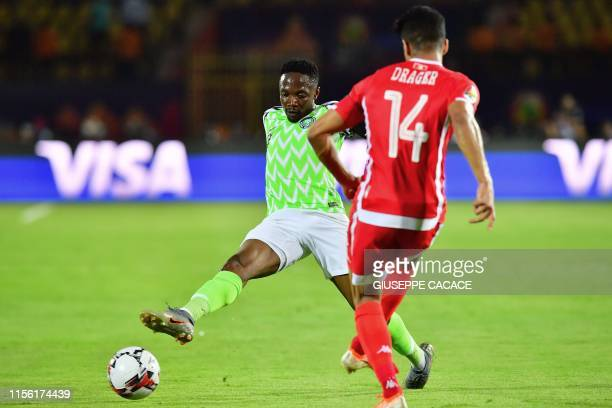 Nigeria's forward Ahmed Musa blocks a shot by Tunisia's defender Mohamed Drager during the 2019 Africa Cup of Nations third place play-off football...
