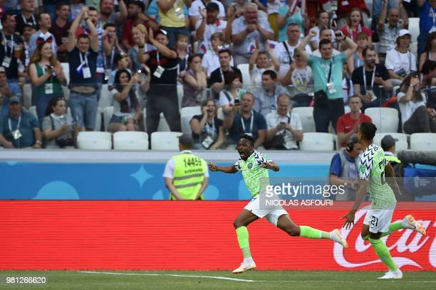 Nigeria's forward Ahmed Musa celebrates past Nigeria's defender Tyronne Ebuehi after scoring their opener during the Russia 2018 World Cup Group D...