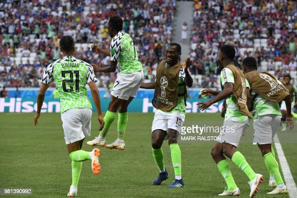 Nigeria's forward Ahmed Musa celebrates past Nigeria's forward Simeon Tochukwu Nwankwo after scoring their opener during the Russia 2018 World Cup...