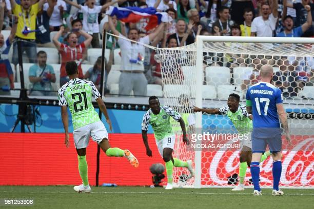 Nigeria's forward Ahmed Musa celebrates past Nigeria's midfielder Oghenekaro Etebo after scoring their opener during the Russia 2018 World Cup Group...