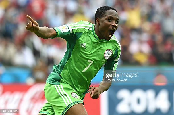 Nigeria's forward Ahmed Musa celebrates scoring his second goal during the Group F football match between Nigeria and Argentina at the BeiraRio...