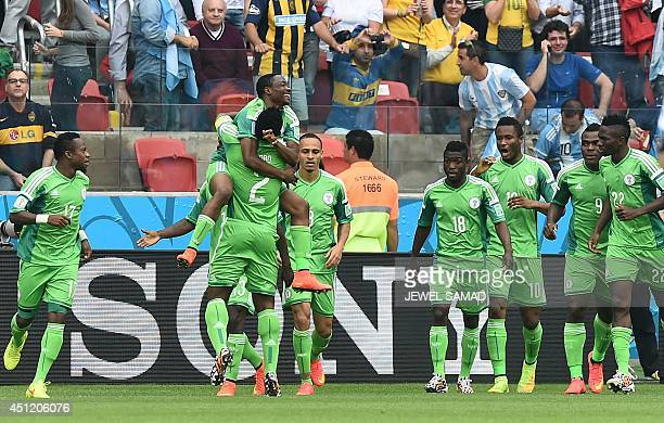 Nigeria's forward Ahmed Musa celebrates with teammate Nigeria's defender and captain Joseph Yobo after scoring during the Group F football match...