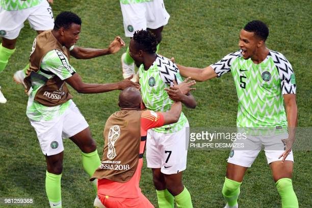 Nigeria's forward Ahmed Musa celebrates with teammates after scoring a goal during the Russia 2018 World Cup Group D football match between Nigeria...