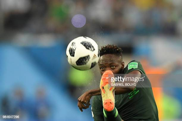 TOPSHOT Nigeria's forward Ahmed Musa controls the ball during the Russia 2018 World Cup Group D football match between Nigeria and Argentina at the...