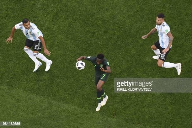 Nigeria's forward Ahmed Musa controls the ball next to Argentina's defender Gabriel Mercado and Argentina's defender Nicolas Otamendi during the...