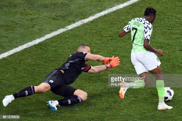 Nigeria's forward Ahmed Musa controls the ball next to Iceland's goalkeeper Hannes Halldorsson before scoring his second goal during the Russia 2018...