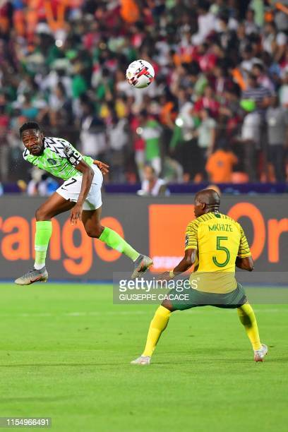 Nigeria's forward Ahmed Musa heads the ball ahead of South Africa's defender Thamsanqa Mkhize during the 2019 Africa Cup of Nations quarter final...